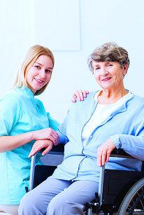 disabled senior and caregiver smiling