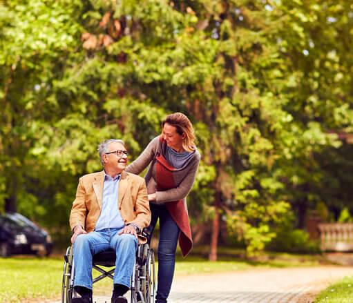 caregiver assisting disabled senior man