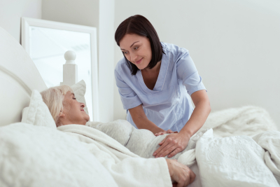 caregiver looking at the senior woman
