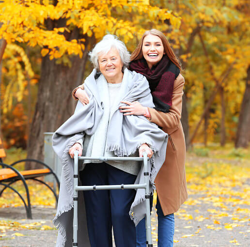 caregiver hugging senior woman