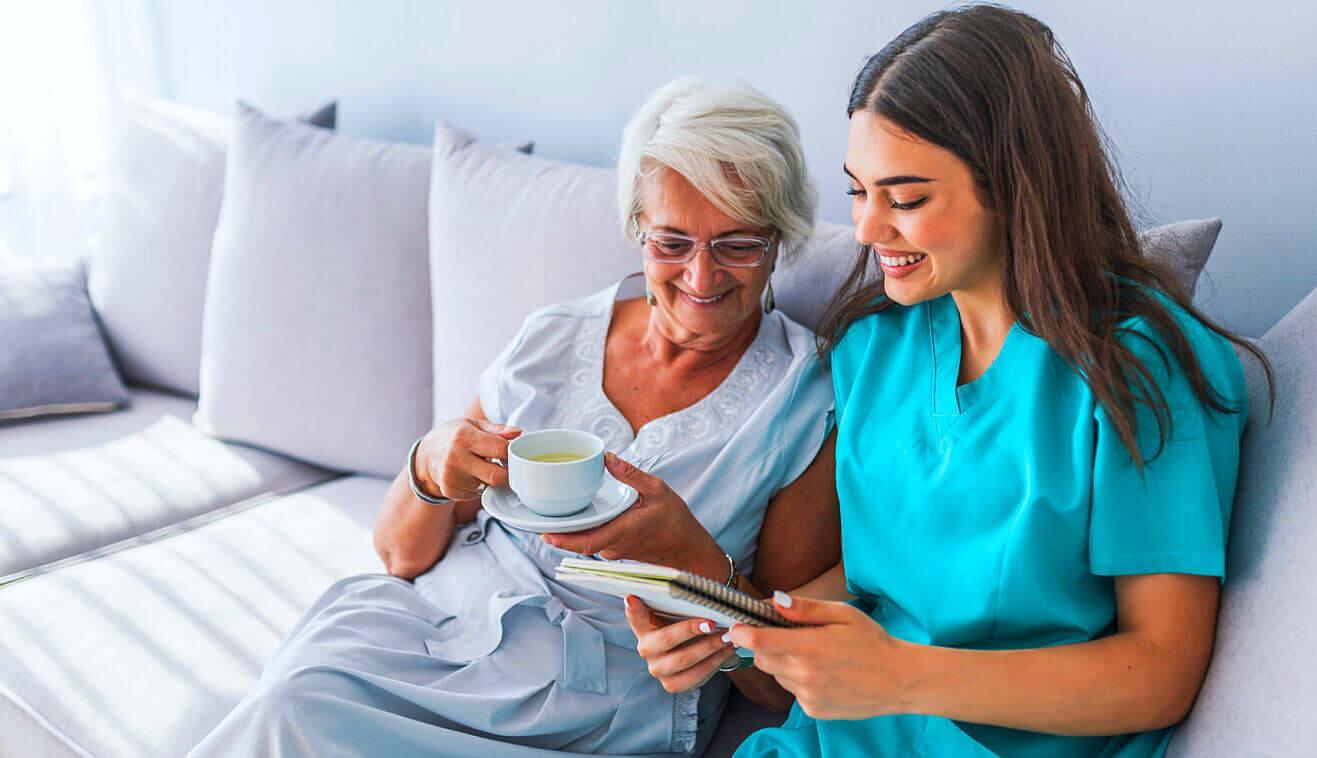 senior and caregiver reading