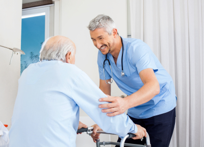 male nurse assisting senior man