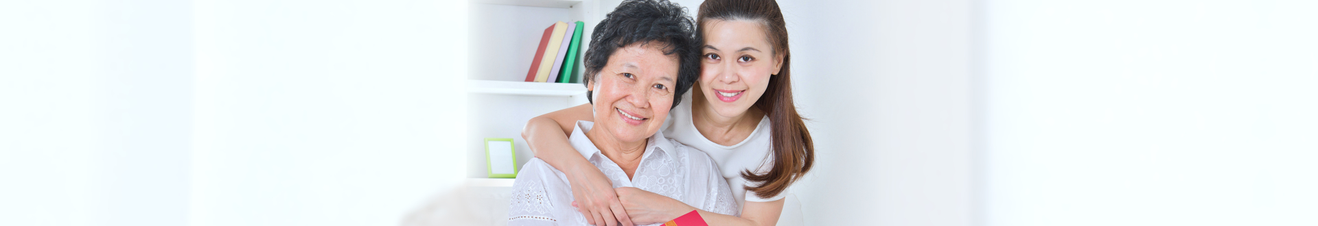 caregiver and disabled senior woman smiling